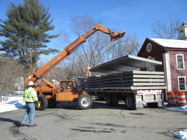 06-Unloading-Light-Weight-Panels.jpg