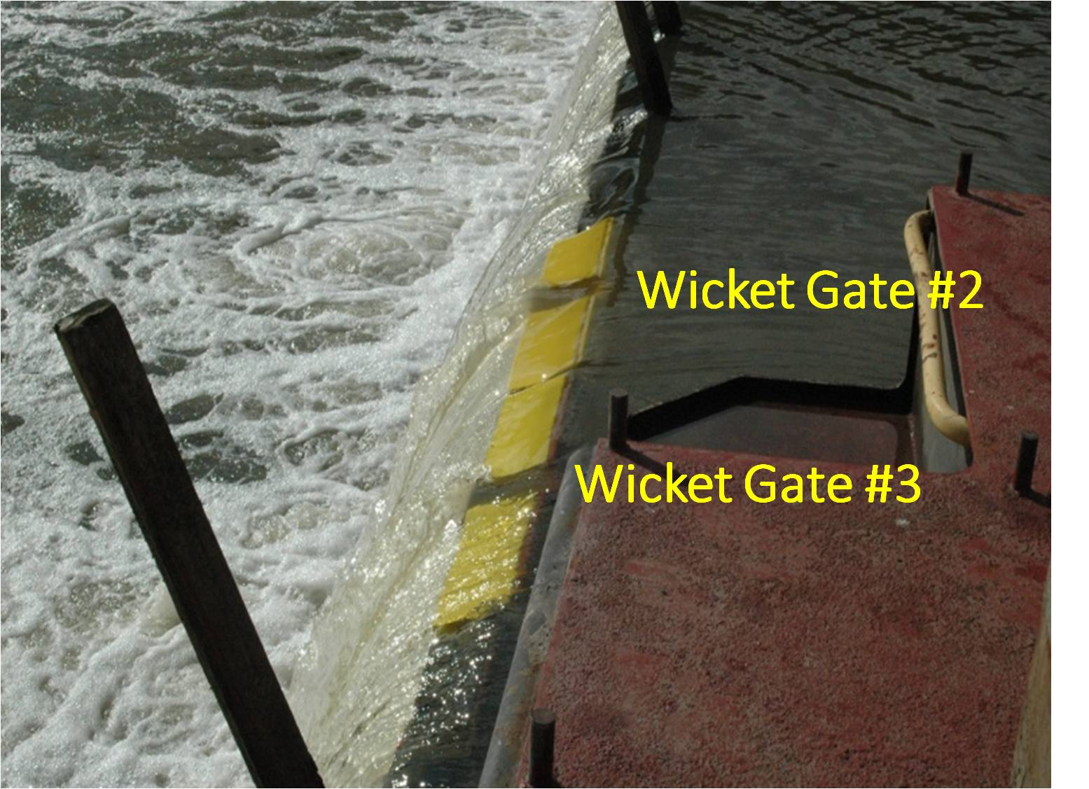 9._Wicket_gates_in_up_position_to_slow_the_flow_of_water.jpg