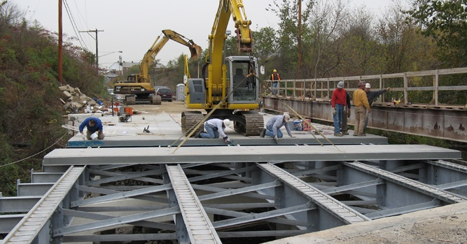 Installing fiberspan vehicle bridge deck